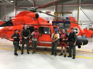 Image: USCG helicopter and crew